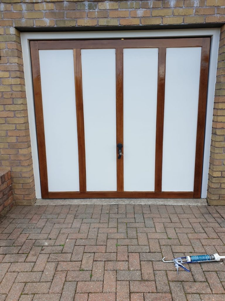 Door completed with Paint and Clear Oil by Exterior Painters Swansea