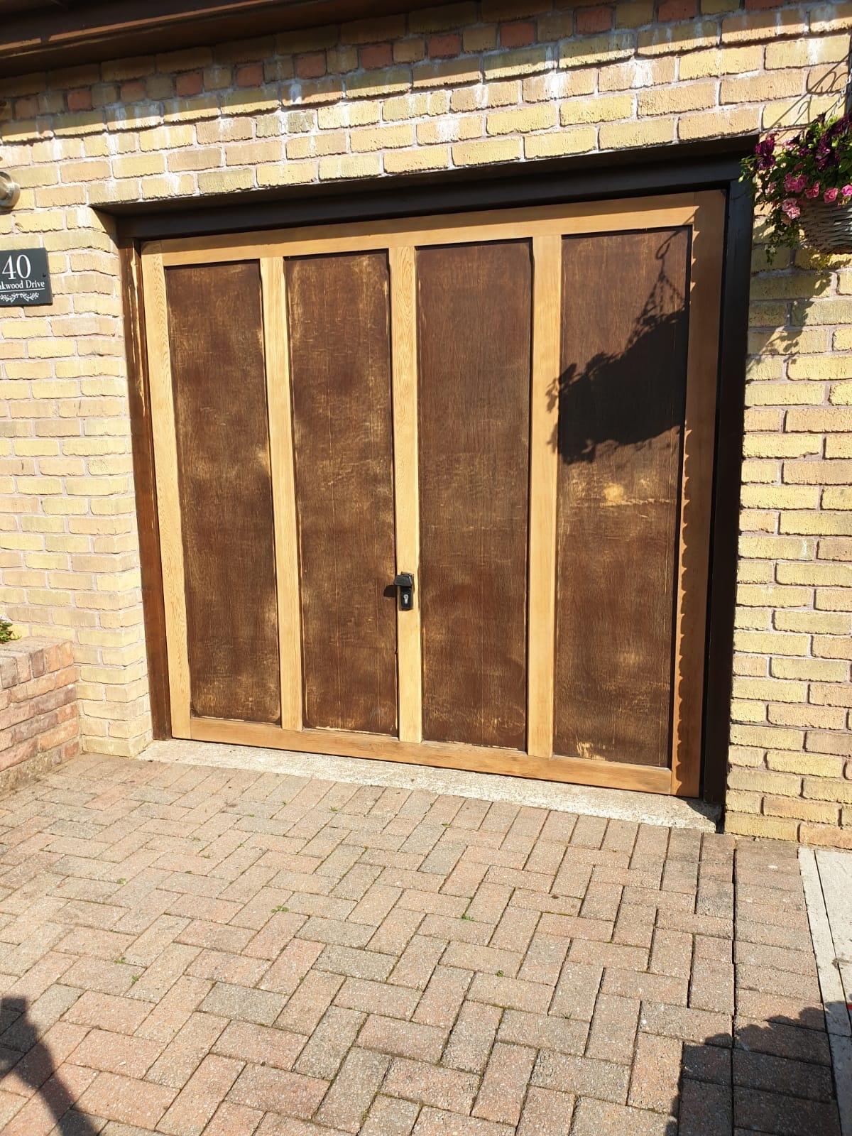 Garage door sanded down before Paintwork by Premier Painters and Decorators Swansea